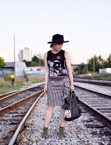 Graphic tank top with felt hat and checked knee-length skirt