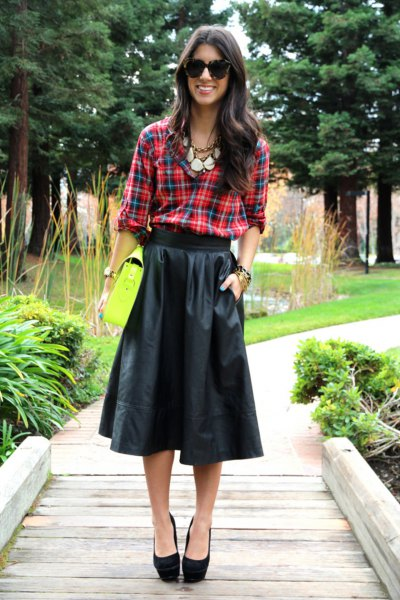 green-blue checked shirt with black flared midi leather skirt