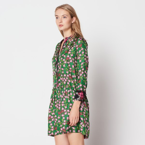 green and white long-sleeved mini dress with floral pattern