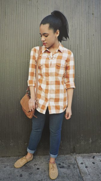 green and white checked shirt with buttons, dark skinny jeans with cuffs and suede shoes