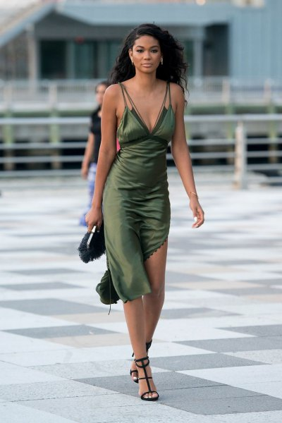 green asymmetrical slip dress made of midi silk with open strappy heels