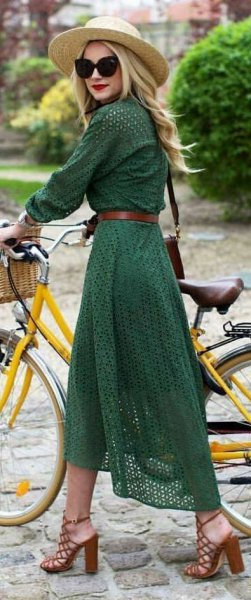 green long-sleeved midi dress with belt and straw hat