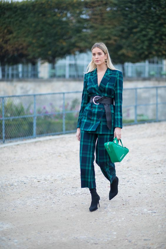 Checked pants suit with a green blazer