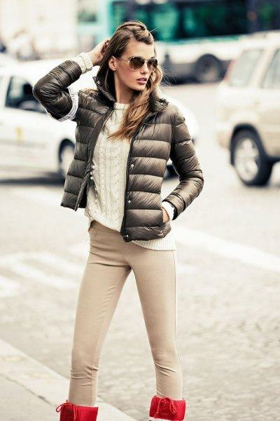 green bubble jacket with white knitted sweater and blushing pink jeans