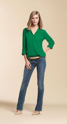 green chiffon blouse with buttons and gray-blue, slightly flared jeans