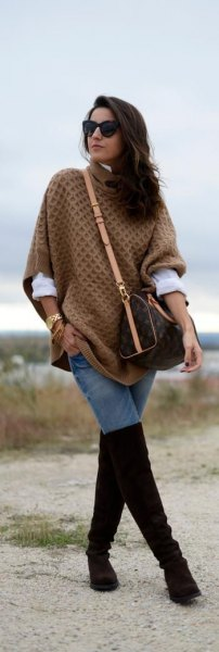 green cable pattern poncho sweater with black overknee boots