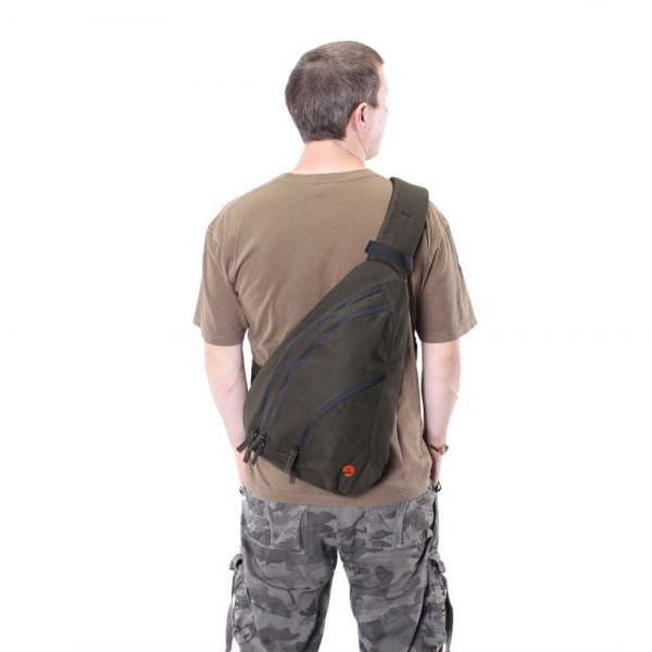green canvas bag with camouflage pants