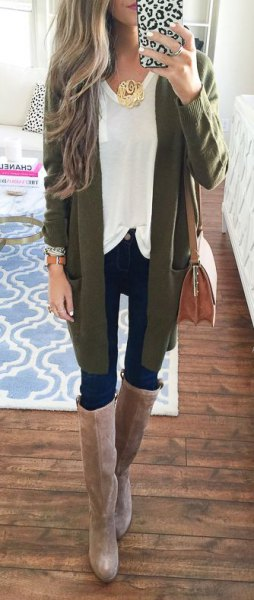 green cardigan with a white top and gray knee-high boots