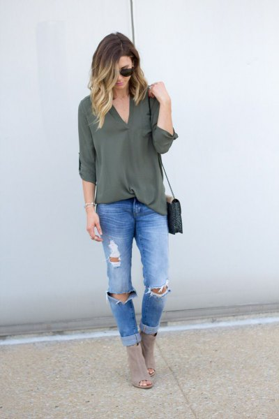 green chiffon layer with blue ribbed slim fit jeans and gray boots