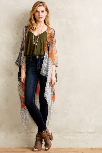 green short top with spaghetti straps, silk cape and dark jeans