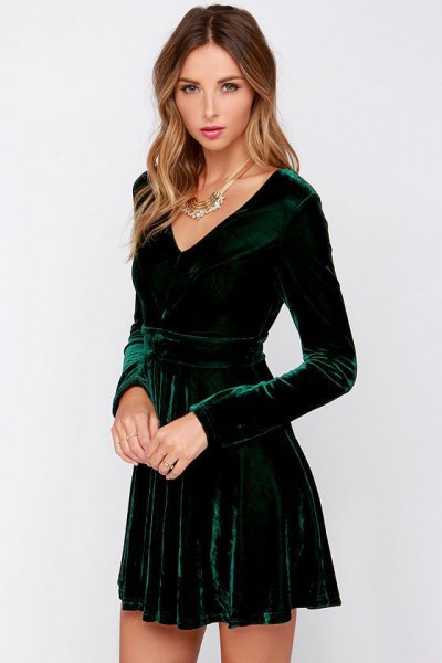 green long-sleeved skater dress with deep V-neckline
