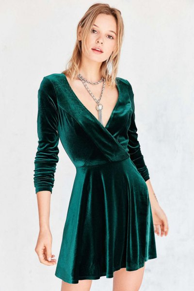 green wrap skater dress with deep V-neckline
