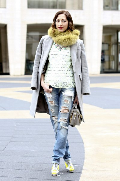 green faux fur scarf with a long gray coat and boyfriend jeans