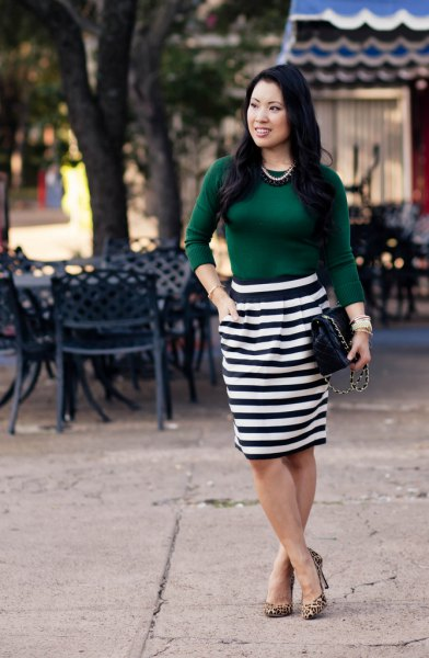 green top with black and white striped knee-length skirt