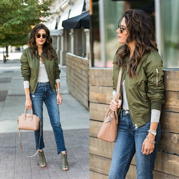 green aviator jacket with gray long-sleeved T-shirt and short jeans