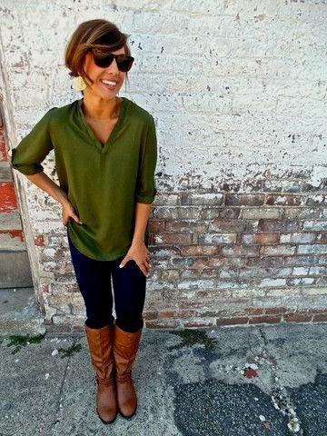 green half-sleeved blouse with brown knee-high leather boots