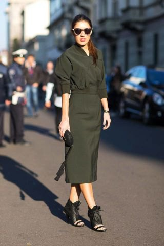 green midi dress with a ruched waist and black open toe boots