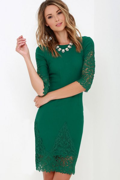 green mini bodycon mini lace dress with half sleeves and white necklace