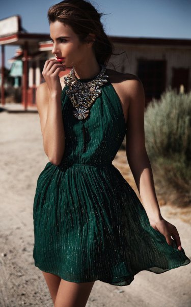 green halterneck ruched waist mini cocktail dress with statement chain
