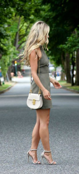 green khaki dress with white leather shoulder bag