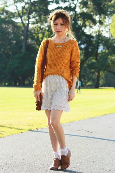 green, chunky knit sweater with white lace shorts and brown oxford suede shoes