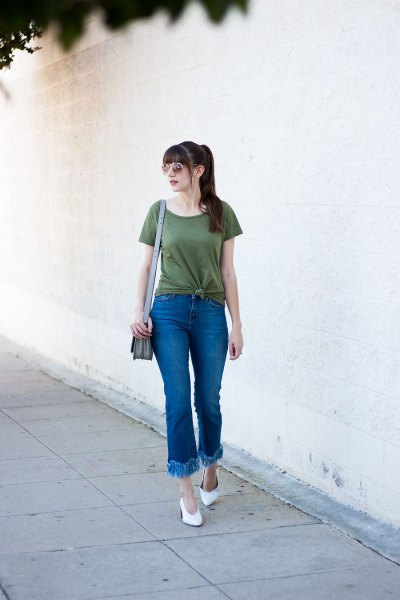 green knotted t-shirt with flared jeans with fringed hem
