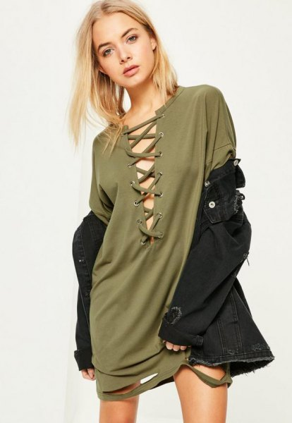 green lace t-shirt dress in front with black denim jacket