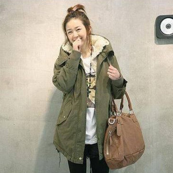 green long parka coat with white printed t-shirt