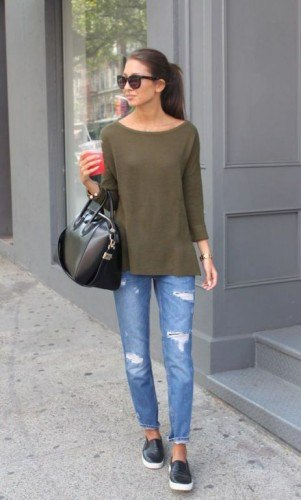 green long-sleeved t-shirt with a boat neckline and ripped slim fit jeans