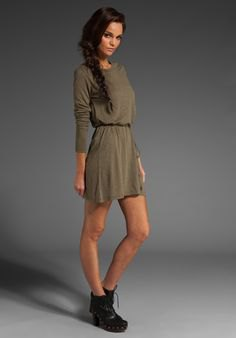 green long-sleeved mini hangover dress with a gathered waist