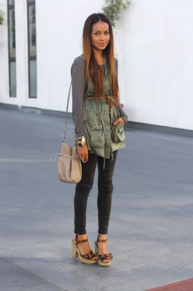 green long-sleeved t-shirt with green military vest with belt