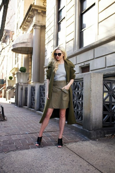 green wool coat with olive-green leather and mini skirt