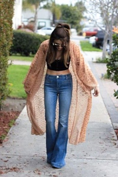 Green midi cardigan with black crop top and flared jeans