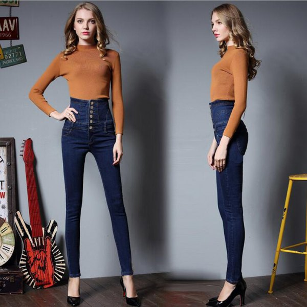 Green knitted sweater with mock neck and dark, high-waisted button fly jeans
