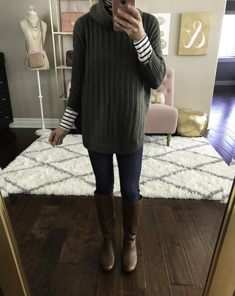 green ribbed sweater with stand-up collar and black and white striped long-sleeved T-shirt