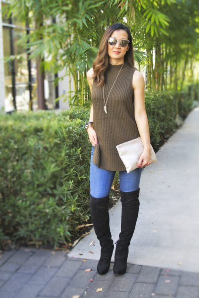 green mock neck torn long sweater with black overknee boots