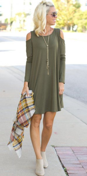 green long-sleeved mini dress with open shoulder