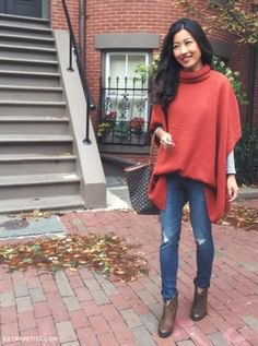 green oversized poncho sweater with mock neck and sleeves