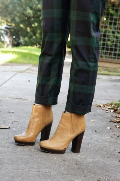 green plaid pants with light brown leather boots with ankle heel
