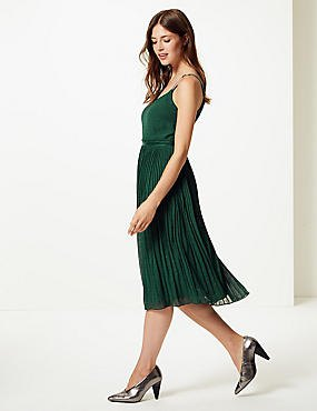 green folded midi dress with silver heels