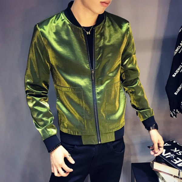 green reflective windbreaker with dark blue skinny jeans