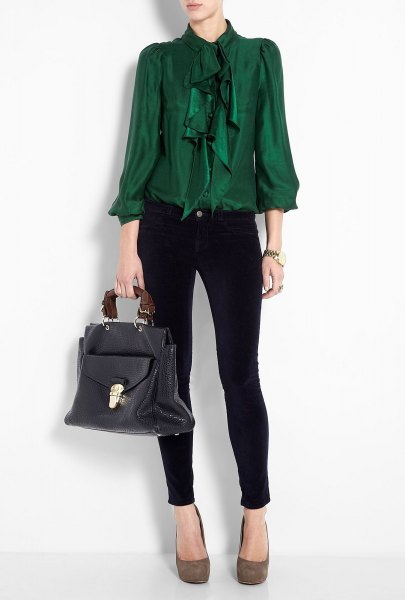 green ruffled bow blouse with black skinny jeans