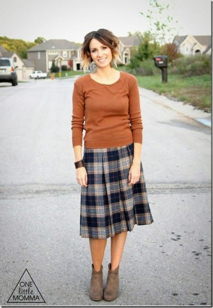 green sweater with scoop neckline and midi plaid pleated skirt