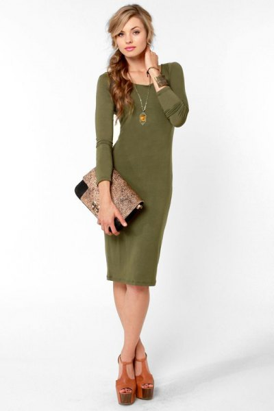 green midi dress with scoop neckline and blushing clutch