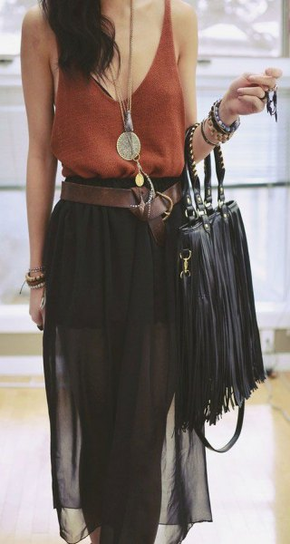 green vest top with scoop neckline, black chiffon midi skirt and leather bag with fringes