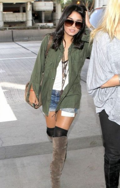 green shirt with a white V-neck top and knee-high boots