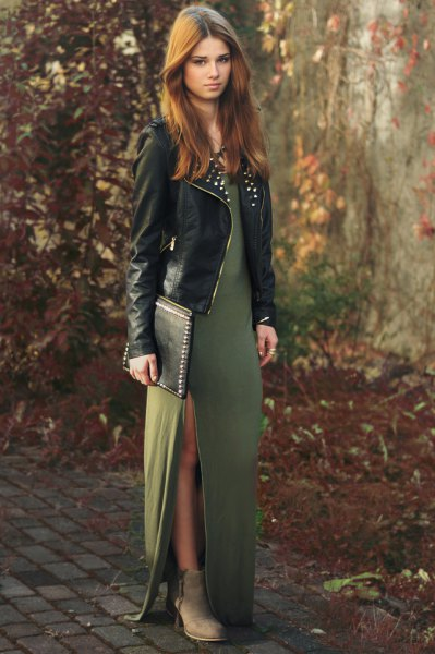 green maxi dress with side slit and leather jacket