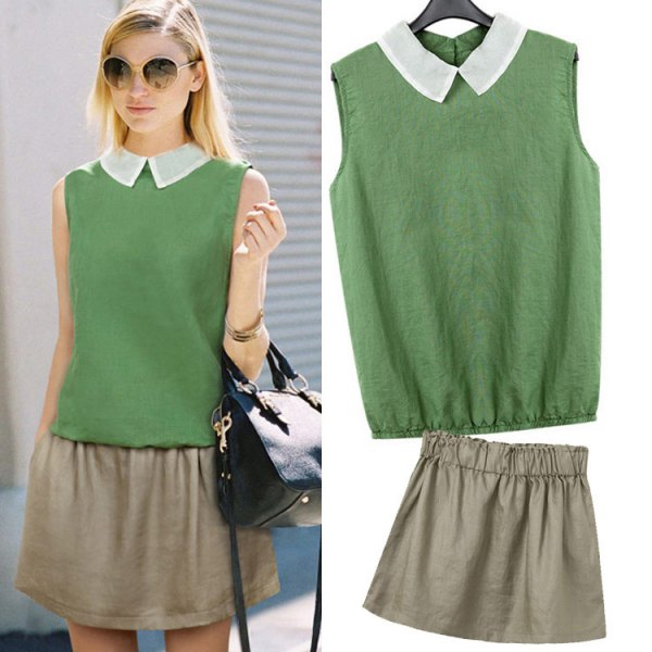 green sleeveless shirt with collar and minirater skirt