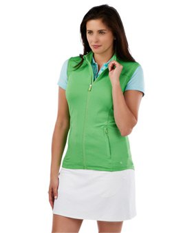green sleeveless polo sweater with light blue T-shirt and white mini skirt