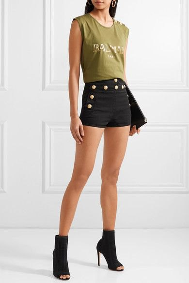 green sleeveless top with black denim designer shorts with button placket